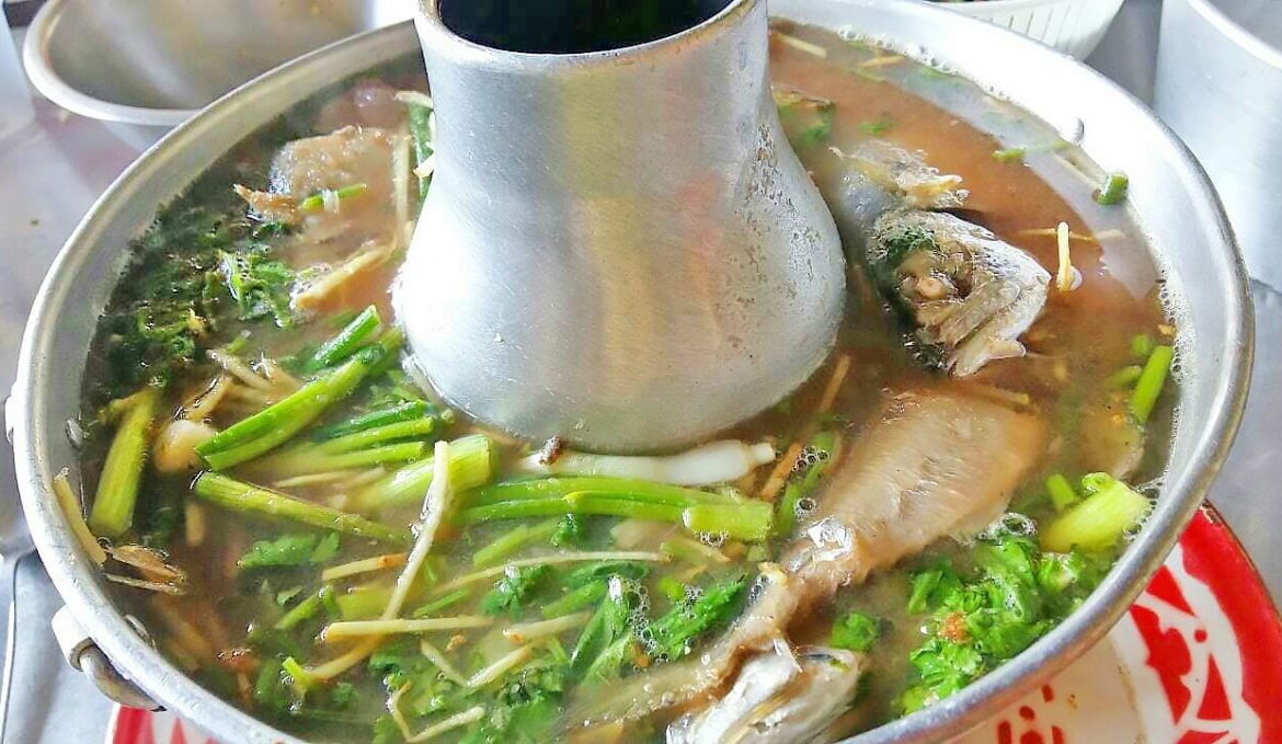 Sweet and sour soup of Thai herbs with mackerel